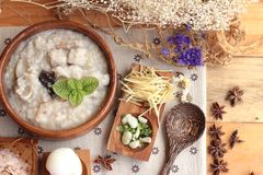 Brown rice porridge put pork and brown rice with soft-boiled egg Stock Photo