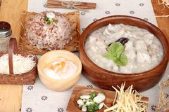 Brown rice porridge put pork and brown rice with soft-boiled egg Royalty Free Stock Photos