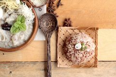 Brown rice porridge put pork and brown rice with soft-boiled egg Stock Photos
