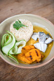 Brown rice with pumpkin soup. royalty free stock images