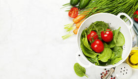 Brown rice and raw fresh vegetables Stock Image