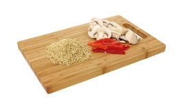 Brown rice red pepper and mushrooms Stock Photo