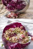 Brown rice with red radicchio and speck Royalty Free Stock Image