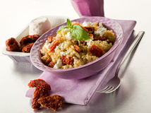 Brown rice with ricotta and tomatoes Stock Photos