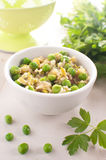 Brown rice risotto with green pesto Royalty Free Stock Photo