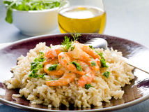 Brown rice with shrimp and arugula. Pesto royalty free stock images