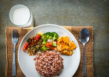 Brown rice with side dish and milk. Royalty Free Stock Photos