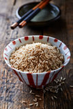 Brown rice in a small bowl Royalty Free Stock Image