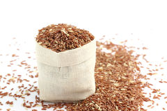 Brown rice in small burlap sack Royalty Free Stock Photos