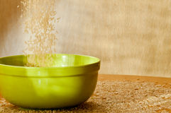 Brown rice is strewed a plate Stock Photo