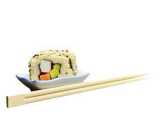 Brown rice sushi and chopsticks isolated on white Royalty Free Stock Image