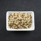 Brown rice on table Stock Photography