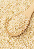 Brown rice and teaspoon Royalty Free Stock Photo