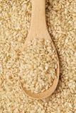 Brown rice and teaspoon Stock Photo