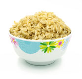 Brown rice on white Royalty Free Stock Image