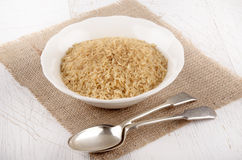 Brown rice in a white bowl Stock Photos