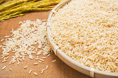 Brown rice on wicker basket Stock Photos