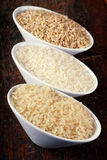 Brown rice, wild rice and white rice Stock Photo