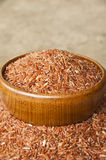 Brown rice. In wood cup have wood table is backgruond Stock Images