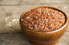 Brown rice. In wood cup have wood table is backgruond Royalty Free Stock Photography