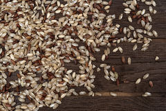 Brown rice on wooden backgroung Royalty Free Stock Photo