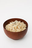 Brown rice in wooden bowl Stock Images