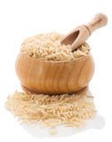 Brown rice in a wooden bowl with a shovel on a white background. Stock Photography