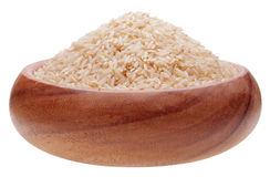 Brown rice in wooden cup Royalty Free Stock Photo