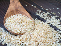 Brown rice in the wooden spoon Stock Images