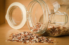 Brown rice on wooden table Stock Image