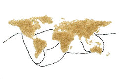 Brown rice world map with trade routes. World map and trade routes made from brown rice. Conceptual image for world trade, globalization, poverty and similar Stock Photography