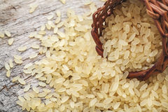 Brown rice. Yellow, used for risotto on a wooden cutting board Stock Photography