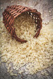 Brown rice. Yellow, used for risotto on a wooden cutting board Royalty Free Stock Image