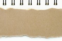 Brown ripped paper on book white paper color background, have copy space for put text royalty free stock images