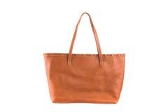 Brown riveste di pelle la tenuta del backgroun isolato borsa femminile di modo Immagine Stock