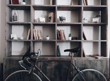 Brown Road Bicycle in Front of Gray Wooden Shelf Cabinet Royalty Free Stock Images