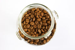 Brown roasted coffee. Jar of brown roasted coffee beans royalty free stock photo