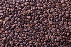 Brown roasted coffee beans, background texture Royalty Free Stock Images