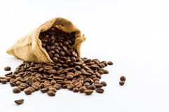 Brown roasted coffee beans in a canvas sack. Stock Photo
