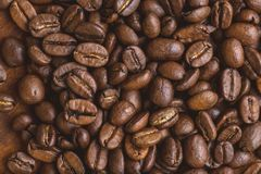 Brown roasted coffee beans, closeup macro for background and texture.  royalty free stock photography