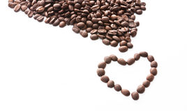 Brown roasted coffee beans in heart shape Stock Image