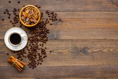 Brown roasted coffee beans scattered on wooden background top view mockup stock image