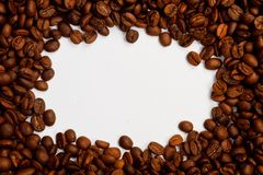 Brown roasted coffee beans. Shot in a studio Royalty Free Stock Photography