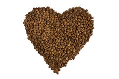 Brown roasted coffee heart. Heart of brown roasted coffee beans isolated on white background royalty free stock images