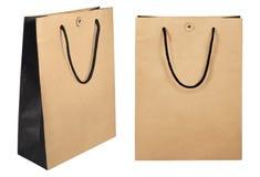 Brown robi zakupy papierowe torby odizolowywać na białym tle z ścinek ścieżką obraz stock