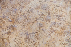 Brown rock abstract  wall background. Vintage beige and brown rock abstract textured wall background Stock Photography