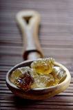Brown rock candy sugar Stock Image