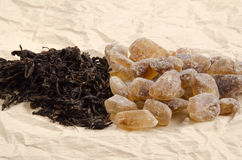 Brown rock candy sugar and black tea Stock Images