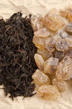 Brown rock candy sugar and black tea Royalty Free Stock Photography