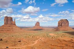 Brown Rock Formation Under White and Blue Cloudy Sky Stock Photo